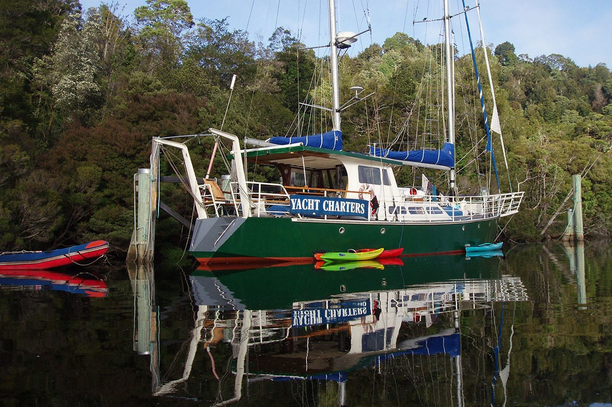 Yacht-with-kayaks-Gordon-River